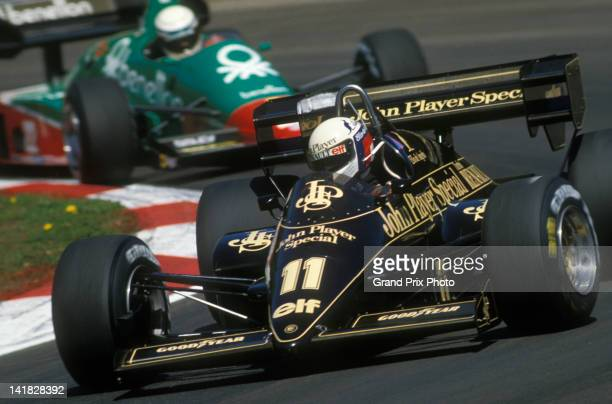 Elio de Angelis of Italy drives the John Player Team Lotus Lotus 95T Renault V6 ahead of compatriot Riccardo Patrese driving the Benetton Team Alfa...