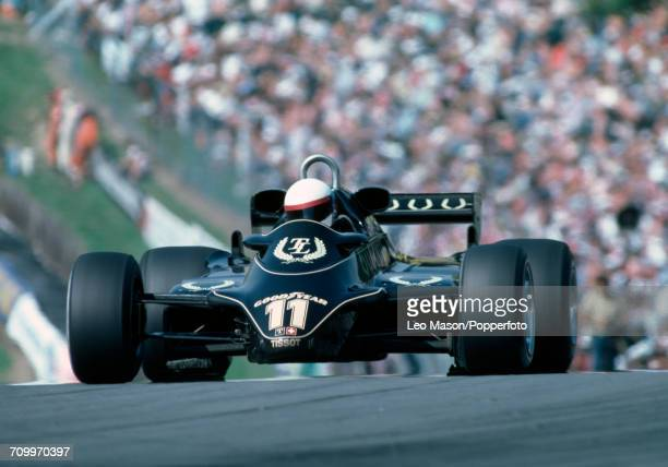 Elio de Angelis of Italy enroute to placing fourth driving a Lotus 91 with a Cosworth V8 engine for John Player Team Lotus during the British Grand...