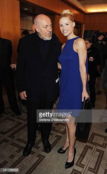 Elio Fiorucci and Michelle Hunziker attend 2011 Premio E' Giornalismo Ceremony at Hotel Four Season on March 22 2012 in Milan Italy