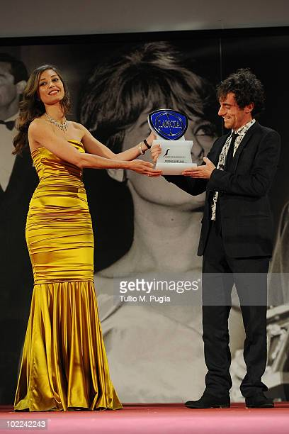 Elio Germano poses with Margaret Made as he receives 'Special Lancia Award for Cinema' at the Nastri d'Argento ceremony awards on June 19 2010 in...
