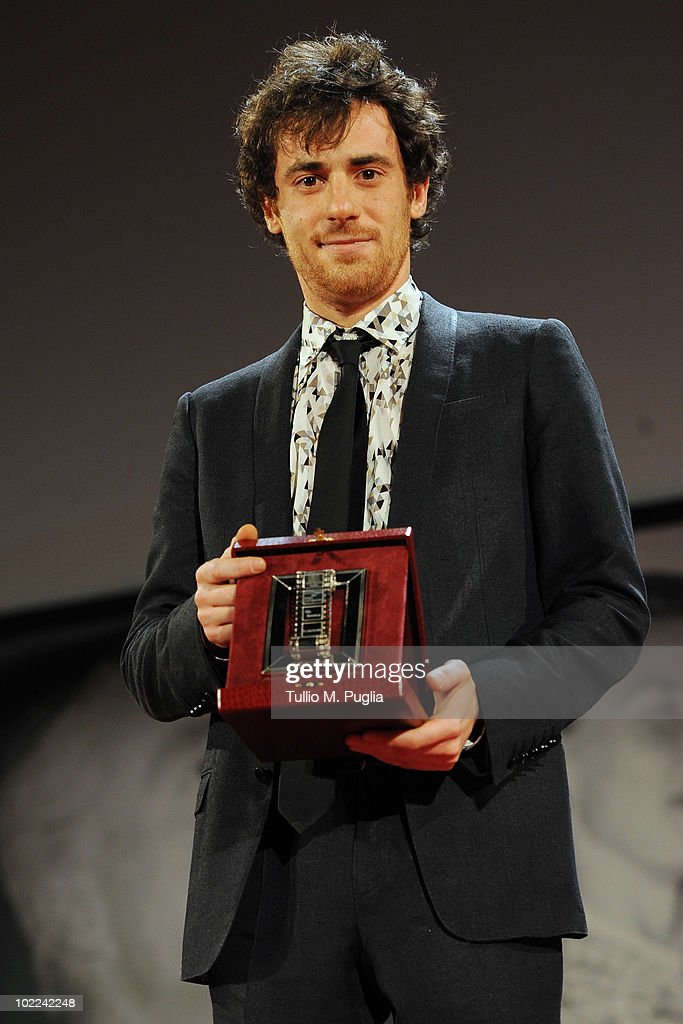 Elio Germano poses with the award for Best Actor (Ex Aequo) during the Nastri d'Argento ceremony awards on June 19, 2010 in Taormina, Italy.