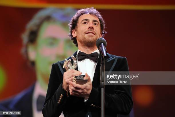 Elio Germano winner of the Silver Bear for Best Actor for the film Hidden Away is seen on stage at the closing ceremony of the 70th Berlinale...