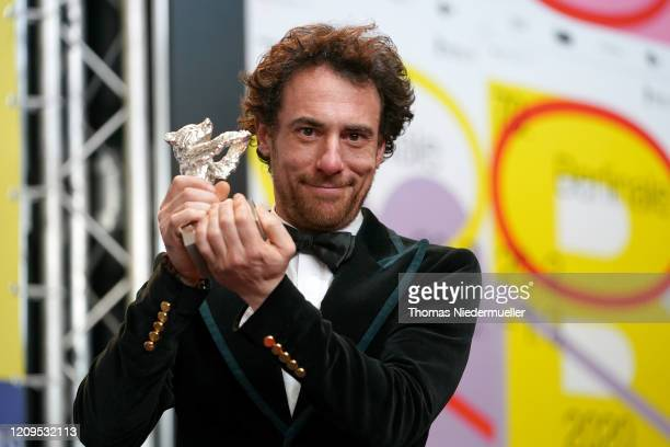 Elio Germano winner of the Silver Bear for Best Actor for the film Hidden Away poses at the award winners press conference during the 70th Berlinale...