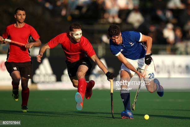 Eliot Curty of France battles with Karim Atef of Egypt during day 8 of the FIH Hockey World League Men's Semi Finals 5th/ 6th place match between...