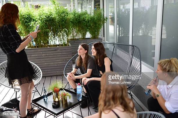 Eliot Paulina Sumner and Lucie Von Alten are being photographed by a guest during the MercedesBenz Fashion Week Berlin Spring/Summer 2017 at Erika...