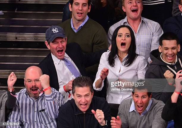 Eliot Spitzer and Lis Smith attend the Dallas Mavericks vs New York Knicks game at Madison Square Garden on February 24 2014 in New York City