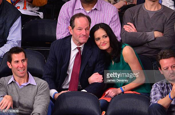 Eliot Spitzer and Lis Smith attend the Philadelphia 76ers vs New York Knicks game at Madison Square Garden on March 10 2014 in New York City