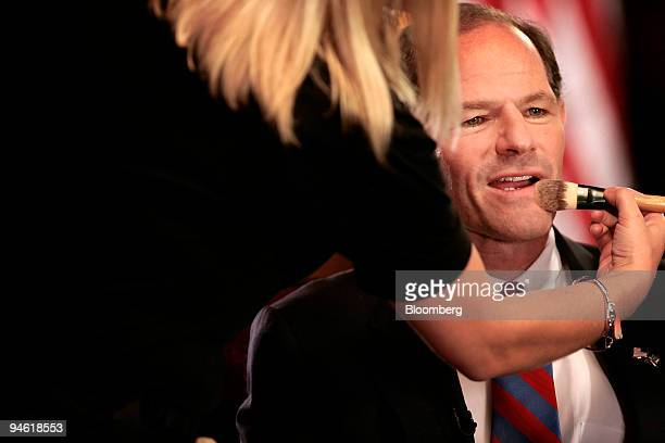 Eliot Spitzer governor of New York has makeup applied to his face prior to an interview in the Red Room at the New York State Capitol in Albany New...