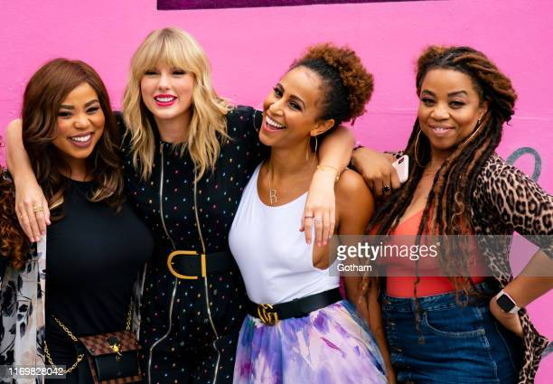 Eliotte Nicole Taylor Swift Melanie Nyema and Kamilah Marshall pose in front of a mural introducing Taylor Swift's latest album Lover on August 23...