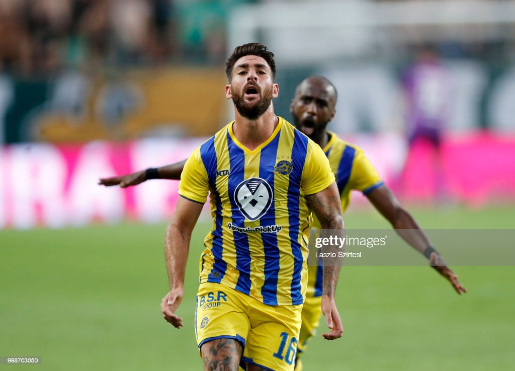 Eliran Atar of Maccabi Tel Aviv FC celebrates his equaliser in front of Eli Dasa of Maccabi Tel Aviv FC during the UEFA Europa League First Qualifying Round 1st Leg match between Ferencvarosi TC and Maccabi Tel Aviv FC at Groupama Arena on July 12, 2018 in Budapest, Hungary.