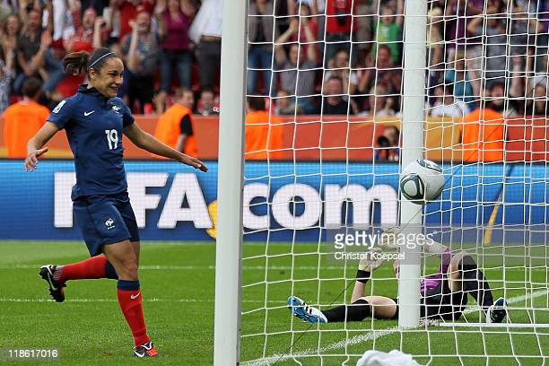 Elis Bussaglia of France scores the first goal against Karen Bardsley of England and Sandrine Bretigny of France puts the ball out of the net during...