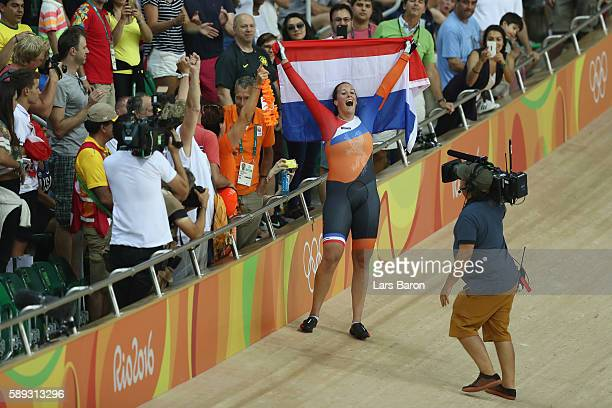 Elis Ligtlee of the Netherlands celebrates winning the gold medal in the during the Women's Keirin Final on Day 8 of the Rio 2016 Olympic Games at...