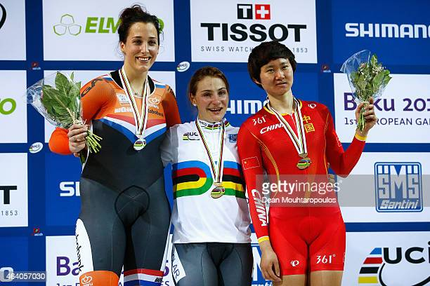 Elis Ligtlee of the Netherlands Kristina Vogel of Germany and Tianshi Zhong of China pose with their medals on the podium in the Women's Sprint Final...