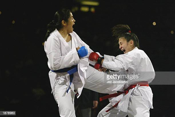 Elisa Au of the USA competes against Yadira Lira of Mexico during the karate portion of the Titan Games at the Events Center at San Jose State on...