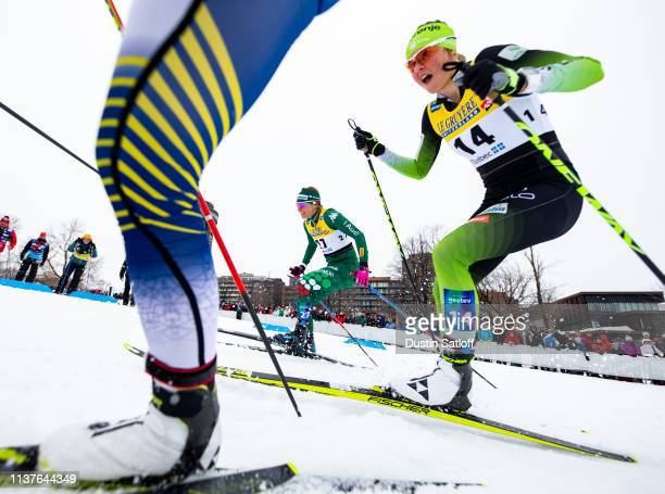 Elisa Brocard of Italy and Anamarija Lampic of Slovenia compete in the sprint quarterfinal heat during the FIS Cross Country Ski World Cup Final on...