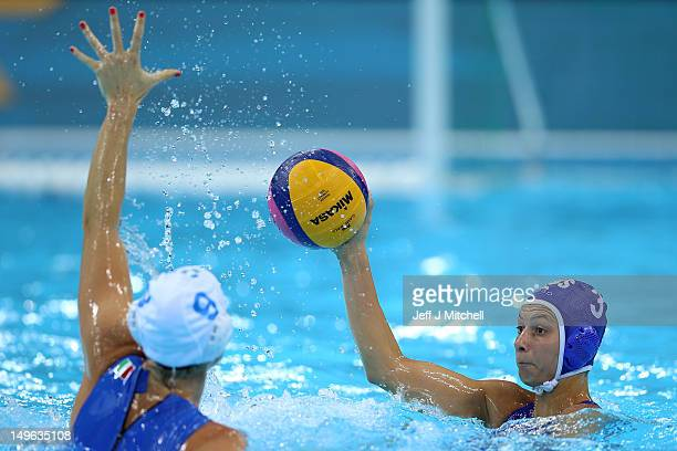 Elisa Casanova of Italy looks to pass in the Women's Preliminary Round match between Italy and Russia on Day 5 of the London 2012 Olympics at Water...