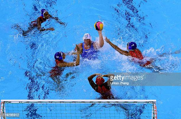 Elisa Casanova of Italy prepares to shoot and score in the Women's Water Polo first preliminary round match between Italy and Cuba during Day Two of...