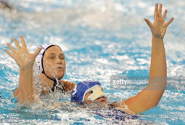 Elisa Casanova of Italy wearing a face mask vies for the ball with Heather Petri of the US in their women's water polo match at the 2008 Beijing...