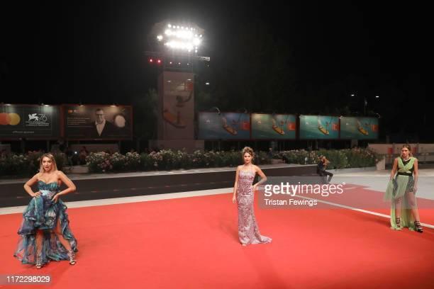Elisa De Panicis Natalia Nigai and Jessica Brugali walks the red carpet ahead of the Mosul screening during the 76th Venice Film Festival at Sala...