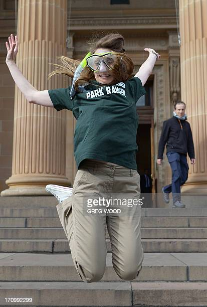 Elisa Detrez from France the winner of the Queensland 'Park Ranger' job in Tourism Australia's 'Best Jobs in the World' competition jumps on the...