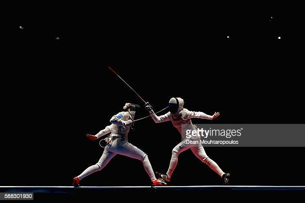 Elisa di Francisca of Italy and Inna Deriglazova of Russia compete during the women's individual foil gold medal bout on Day 5 of the Rio 2016...