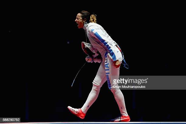 Elisa di Francisca of Italy celebrates victory over Ines Boubakri of Tunisia during the women's individual foil semifinal on Day 5 of the Rio 2016...