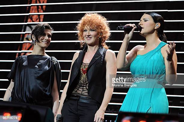 Elisa Fiorella Mannoia and Laura Pausini perform at the charity concert Amiche Per L'Abruzzo on June 21 2009 in Milan Italy