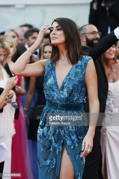 Elisa Isoardi walks the red carpet ahead of the opening ceremony and the 'First Man' screening during the 75th Venice Film Festival at Sala Grande on...