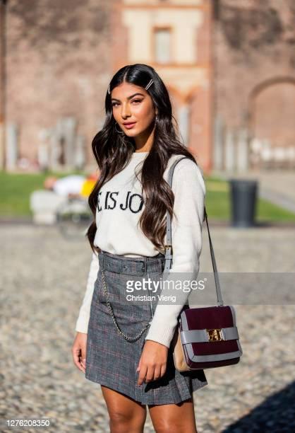 Elisa Maino is seen wearing grey skirt, knit, bag outside Alberta Ferretti during the Milan Women's Fashion Week on September 23, 2020 in Milan,...