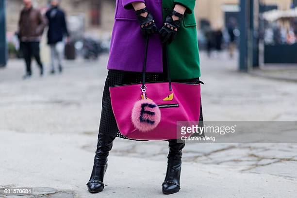 Elisa Mastella is wearing a Fendi Tote monster eye bag in saffiano and purple green coat gloves on January 12 2017 in Florence Italy