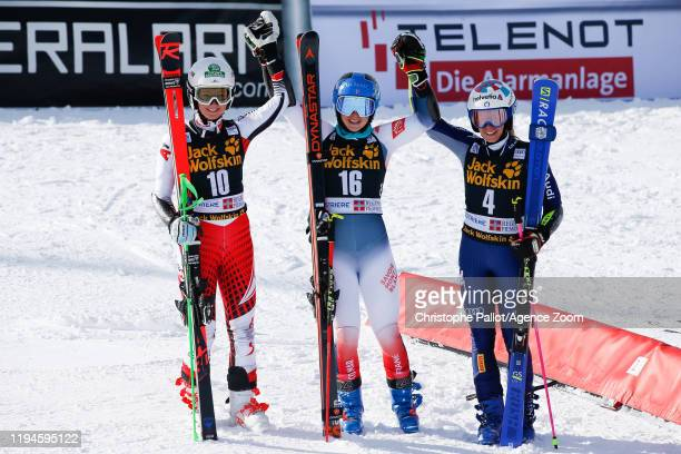 Elisa Moerzinger of Austria takes 2nd place, Clara Direz of France takes 1st place, Marta Bassino of Italy takes 3rd place during the Audi FIS Alpine...