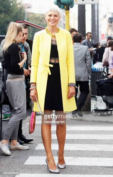 Elisa Nalin attends the Aberta Ferretti show wearing a Red Valentino coat a vintage dress and Valentino shoes during Milan Fashion Week Womenswear...