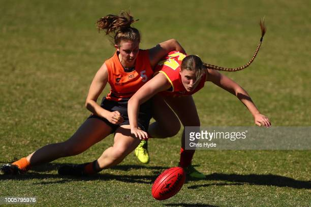 Elisa Pevere of the Giants and Madison Goodwin of the Suns compete for the ball during the round two AFLW Winter Series match between the Gold Coast...