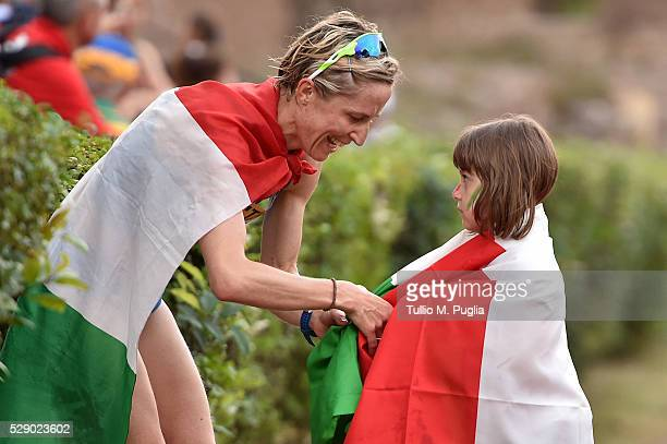 Elisa Rigaudo celebrates with her daughter after arriving at finish line of the woman's 20Km Race Walk at IAAF World Race Walking Team Championship...