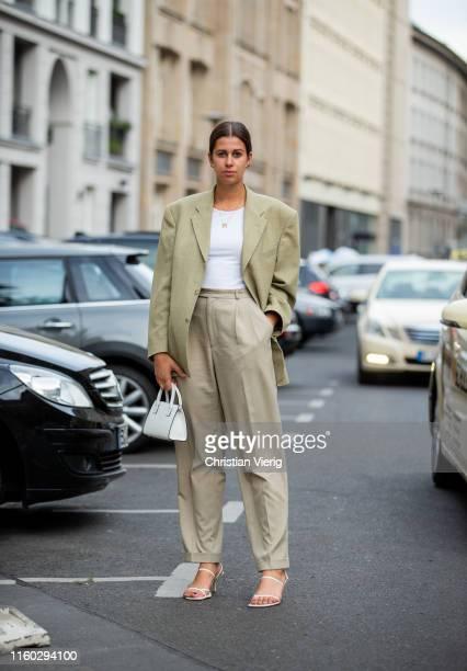 Elisa Schenke is seen wearing beige pants blazer white bag white tshirt outside Nobi Talai during Berlin Fashion Week on July 04 2019 in Berlin...