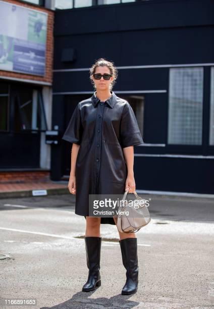 Elisa Schenke is seen wearing black leather dress Loewe bag boots outside By Malene Birger during Copenhagen Fashion Week Spring/Summer 2020 on...