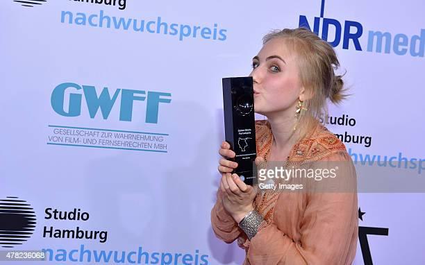 Elisa Schlott poses with her award during the Studio Hamburg Nachwuchspreis 2015 at Thalia Theater on June 23 2015 in Hamburg Germany