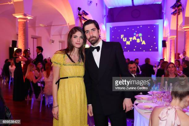 Elisa Sednaoui and Carlo Borromeo attend Elisa Sednaoui Foundation and Yoox Net a Porter Event on March 28 2017 in Milan Italy