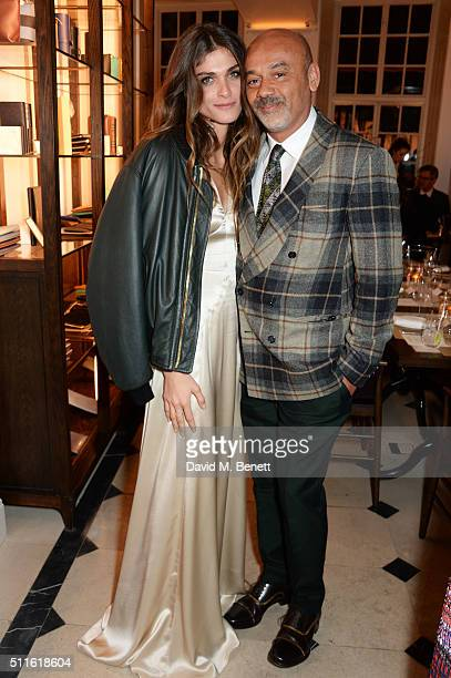 Elisa SednaouiDellal and Christian Louboutin attend as mytheresacom and Burberry celebrate the new MYT Woman at Thomas's on February 21 2016 in...