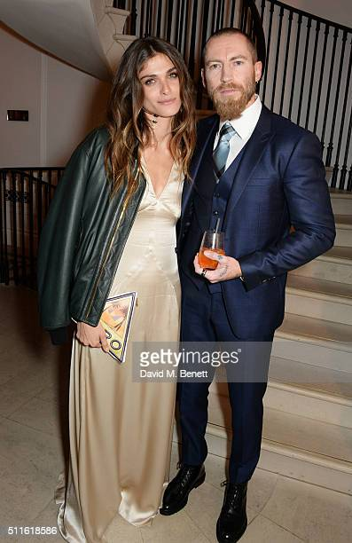 Elisa SednaouiDellal and Justin O'Shea attend as mytheresacom and Burberry celebrate the new MYT Woman at Thomas's on February 21 2016 in London...