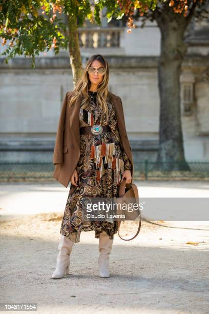 Elisa Taviti wearing a maxi printed dress brown blazer white boot and tan bag is seen before the Elie Saab show on September 29 2018 in Paris France