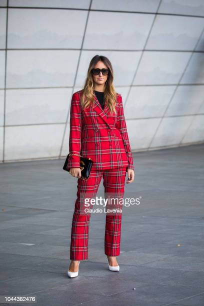 Elisa Taviti wearing a red checked suit white heels and black bag is seen after the Giambattista Valli show on October 1 2018 in Paris France