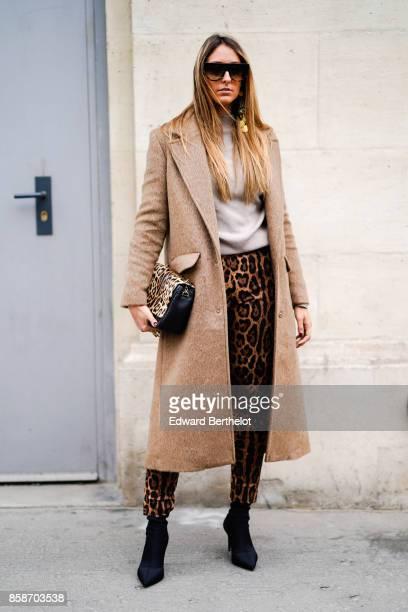 Elisa Taviti wears sunglasses a beige coat a gray top leopard print pants black shoes outside Giambattista Valli during Paris Fashion Week Womenswear...