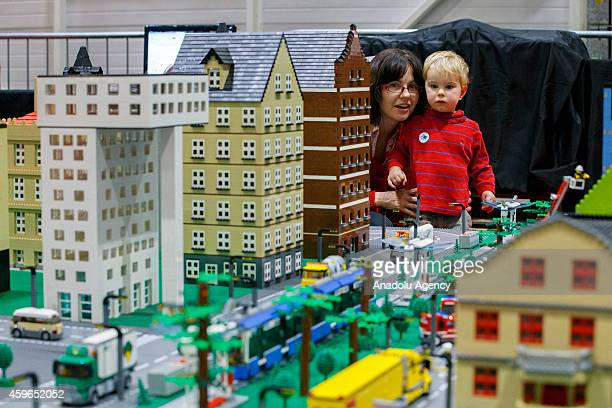 Elisabeth Baraka and Lincoln Baraka look at the 10 x 3 metres Lego city on the opening day of the Lego show 'Brick 2014' opens at Excel Centre in...