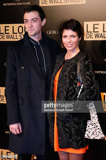 Elisabeth Bourgine and her son attend the photocall before the 'The Wolf of Wall Street' World movie Premiere at Cinema Gaumont Opera on December 9,...