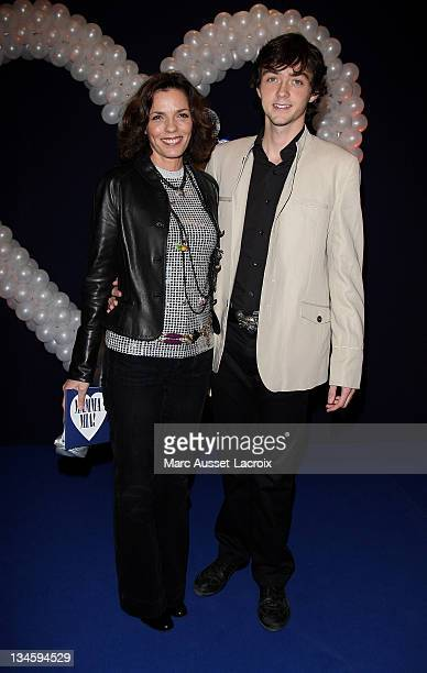 Elisabeth Bourgine and his son Jules poses for the premiere of 'Mamma Mia' Paris Premiere at Theatre Mogador on October 28 2010 in Paris France