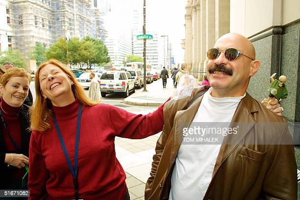 Elisabeth Buffy Hall and Meg Wakeman the sisters of Holly Maddux rejoice outside the Criminal Justice Center in Philadelphia PA 17 October 2002 with...