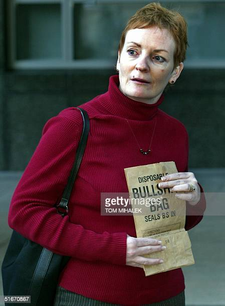 Elisabeth Buffy Maddux a sister of Holly Maddux holds a bag at a press conference following a day of testimony by accused killer Ira Einhorn 14...