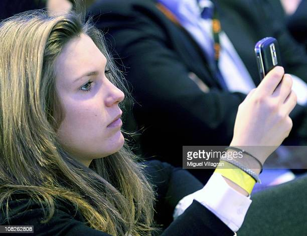 Elisabeth Burda the daughter of publisher and DLDCoChairman Hubert Burda takes a picture with her cellular phone during the Digital Life Design...