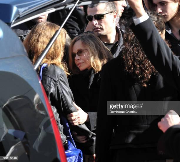 Elisabeth Depardieu holds her daughter Julie Depardieu after Guillaume Depardieu's funeral service at Notre-Damme Church on October 17, 2008 in...